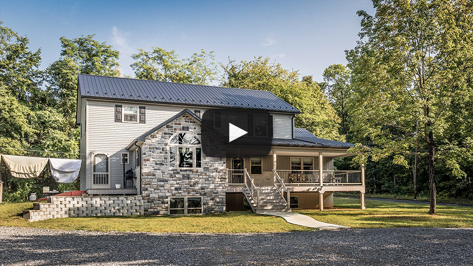 Building Showcase: Amish House with Textured Black Metal Roof