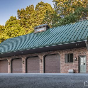 Brick Garage with Green Standing Seam Roof